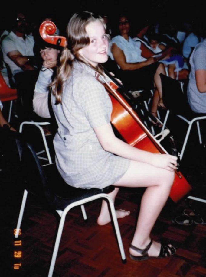 Bronwen in school uniform with cello in rest position
